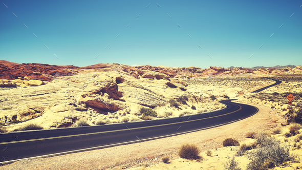Vintage toned desert road, travel concept. - Stock Photo - Images