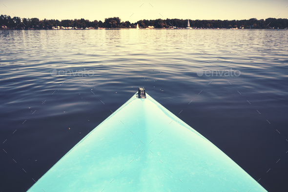 Bow of a kayak on a still lake. - Stock Photo - Images