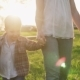 Mother and Kids Holding Hands and Running Together on Grass at Sunset - VideoHive Item for Sale