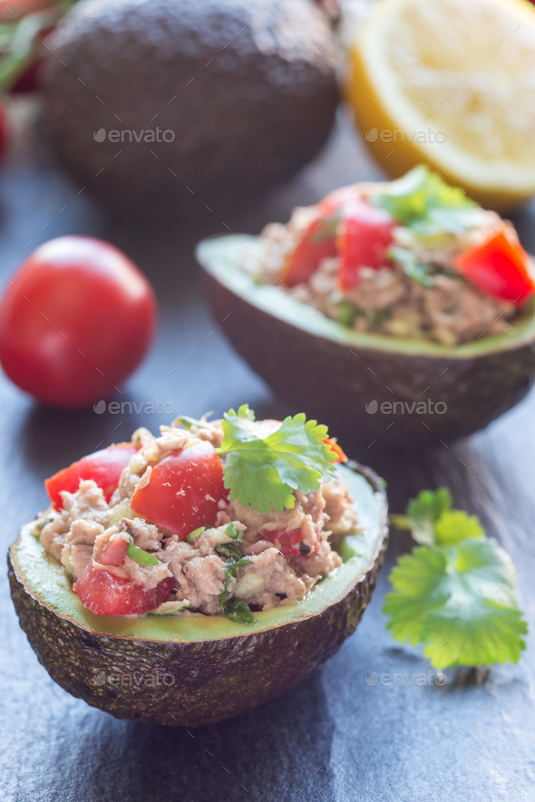 Salad with tuna, avocado, tomatos, coriander and lemon juice ser - Stock Photo - Images