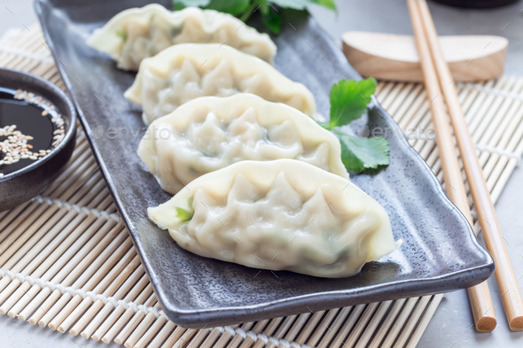 Steamed Korean dumplings Mandu with chicken meat and vegetables - Stock Photo - Images