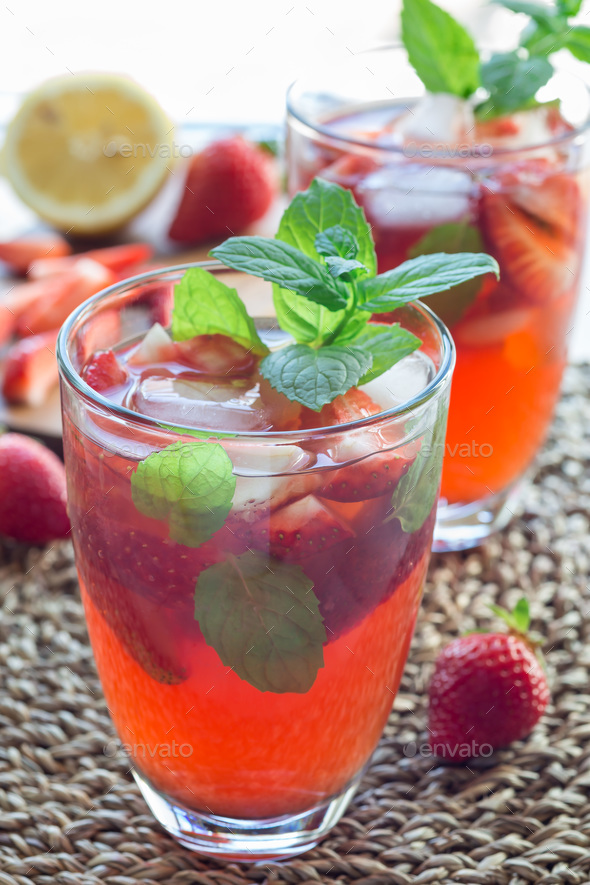 Glass of refreshing iced tea with strawberries and mint, vertica - Stock Photo - Images