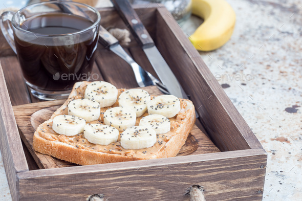 Healthy sandwich with crunchy peanut butter, banana and chia see - Stock Photo - Images