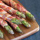 Healthy appetizer, green asparagus wrapped with bacon on wooden - PhotoDune Item for Sale
