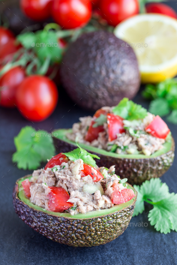 Salad with tuna, avocado, tomatos, coriander and lemon juice ser - Stock Photo - Images