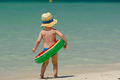 Toddler boy with swim ring on beach - PhotoDune Item for Sale