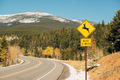 Deer crossing sign on highway at autumn - PhotoDune Item for Sale