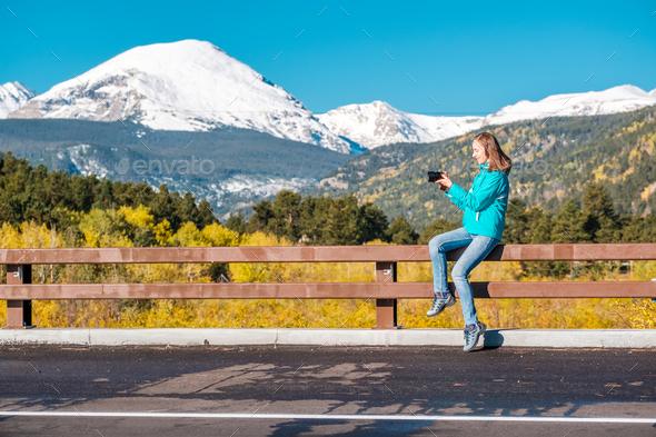 Tourist taking photo in Rocky Mountains at autumn, Colorado, USA. - Stock Photo - Images