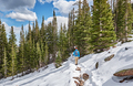 Tourist with backpack hiking on snowy trail - PhotoDune Item for Sale