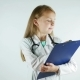 Lovely Little Girl Shows Serious Doctor, Writes Medical Prescription - VideoHive Item for Sale