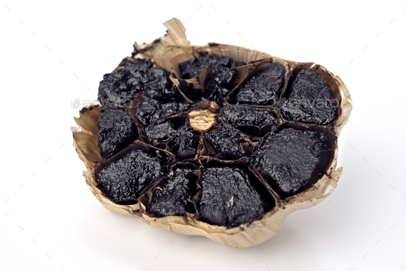 aromatic black garlic isolated on white background - Stock Photo - Images