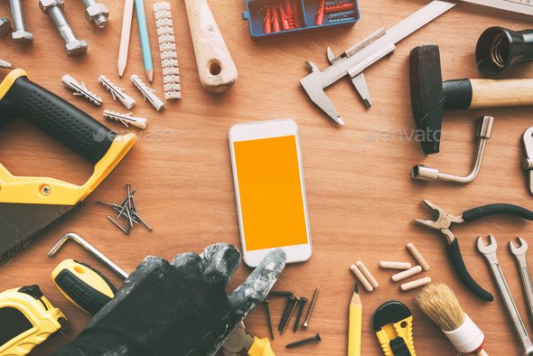 Handyperson smart phone app, repairman holding mobile phone in h - Stock Photo - Images