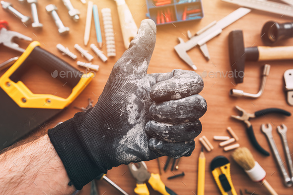 Repairman showing OK thumb up approval hand sign, top view - Stock Photo - Images