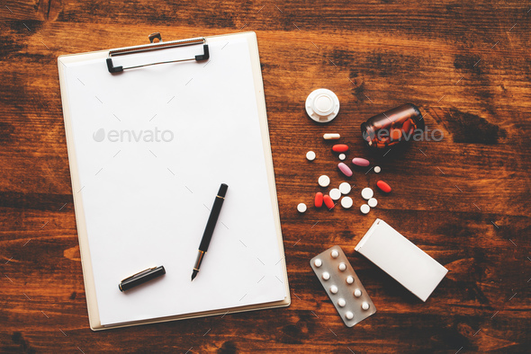 Overhead view of medical doctor office desk - Stock Photo - Images