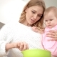 Young Mother Cooking with Baby on Hands. Baby Nutrition Cooking - VideoHive Item for Sale