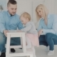 Happy Family with Their Lovely Baby Near the Chair. - VideoHive Item for Sale
