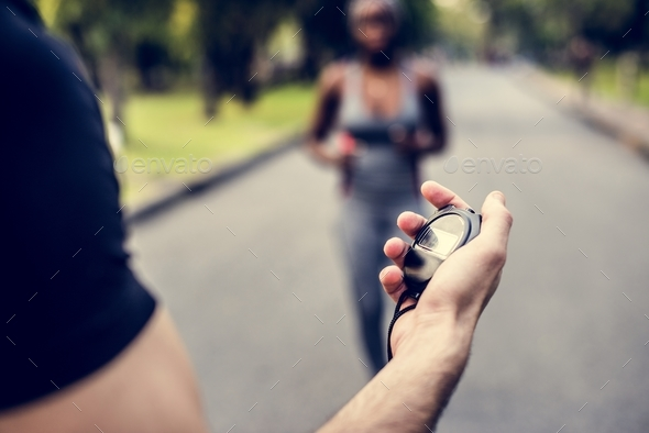 Hand holding a stopwatch - Stock Photo - Images
