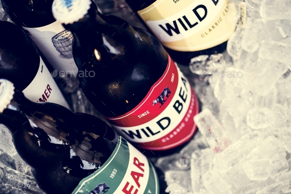 Closeup of beers chilling in ice - Stock Photo - Images