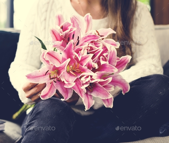 Woman with lily flower bouquet - Stock Photo - Images
