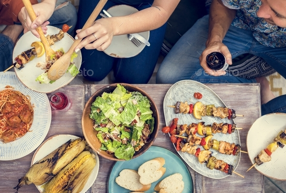 Diverse people eating food togethr - Stock Photo - Images