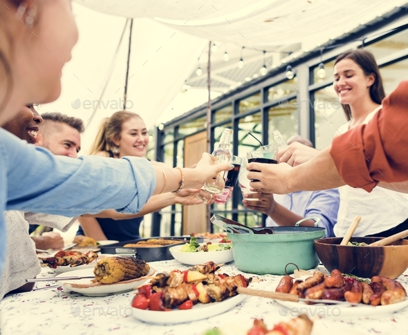 Group of diverse friends enjoying summer party together - Stock Photo - Images