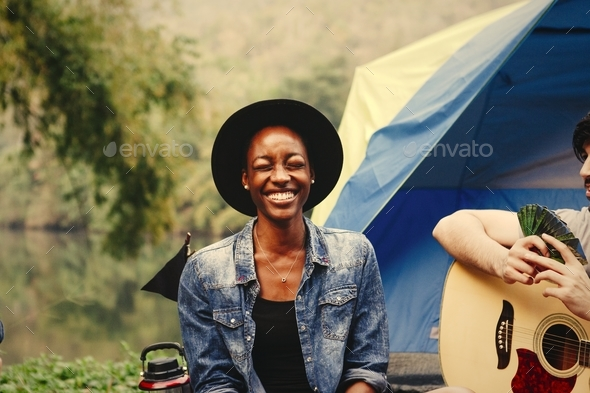 Happy woman at a campsite - Stock Photo - Images