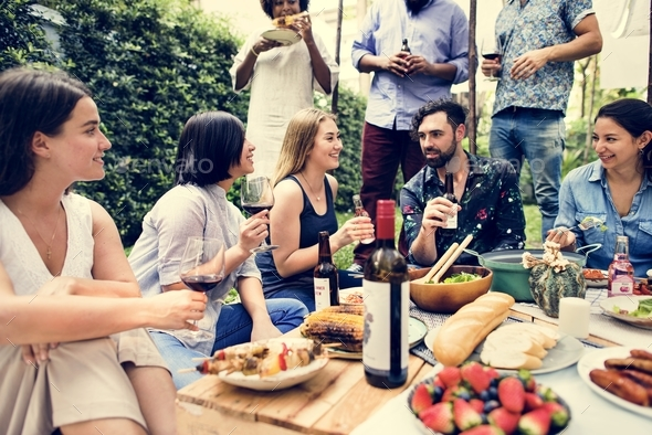 Summer party of friends in the garden - Stock Photo - Images