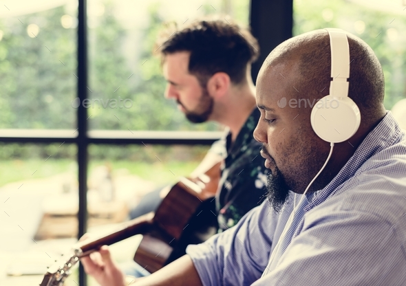 Men enjoying the music together - Stock Photo - Images