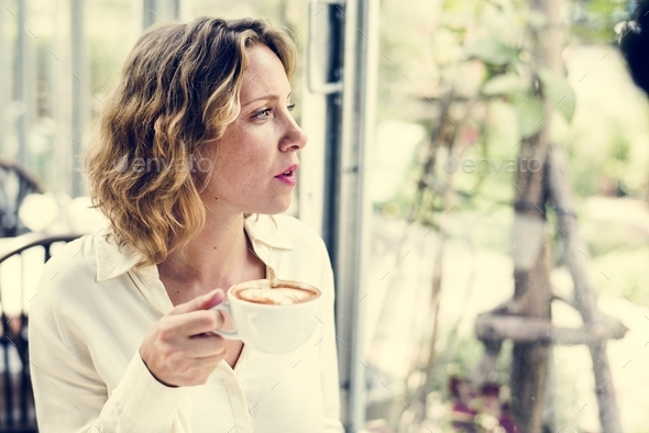 Woman with a cup of coffee - Stock Photo - Images