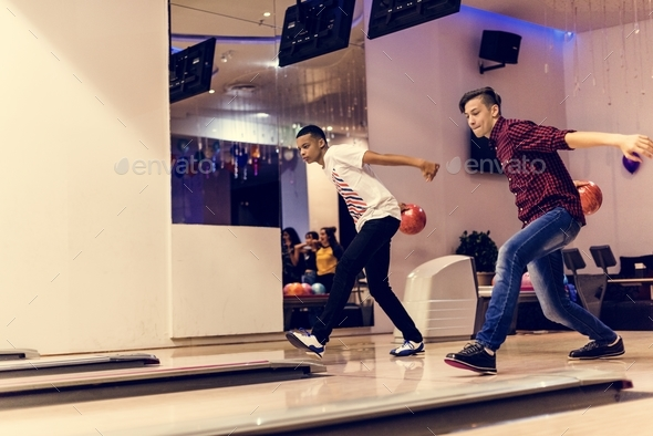 Teen boys bowling together - Stock Photo - Images