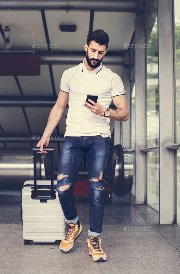 White man carrying luggage - Stock Photo - Images
