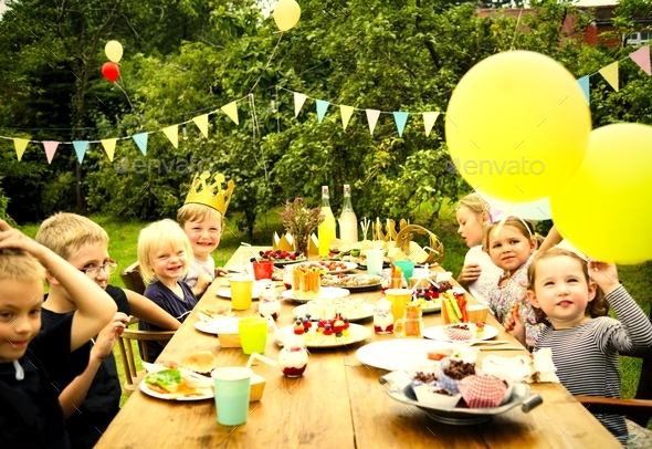 Kids enjoying the party in the garden - Stock Photo - Images