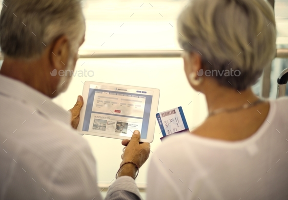 Senior couple traveling airport scene - Stock Photo - Images