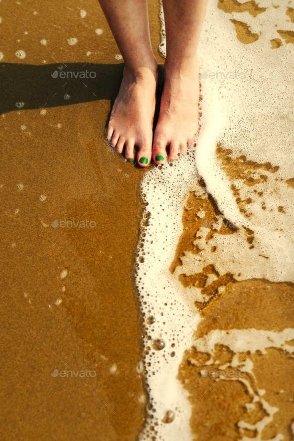 A caucasian woman is enjoying the summer time - Stock Photo - Images