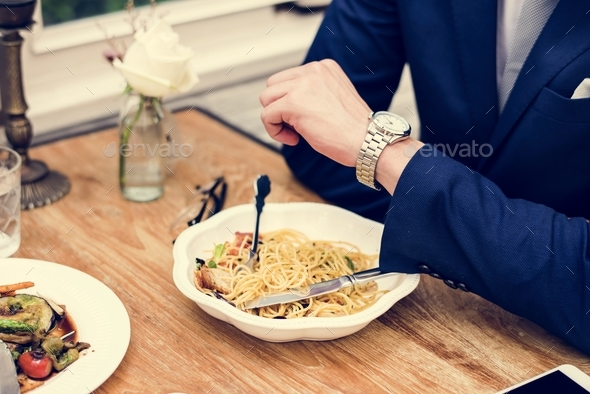 Businessman waiting at the restaurant - Stock Photo - Images