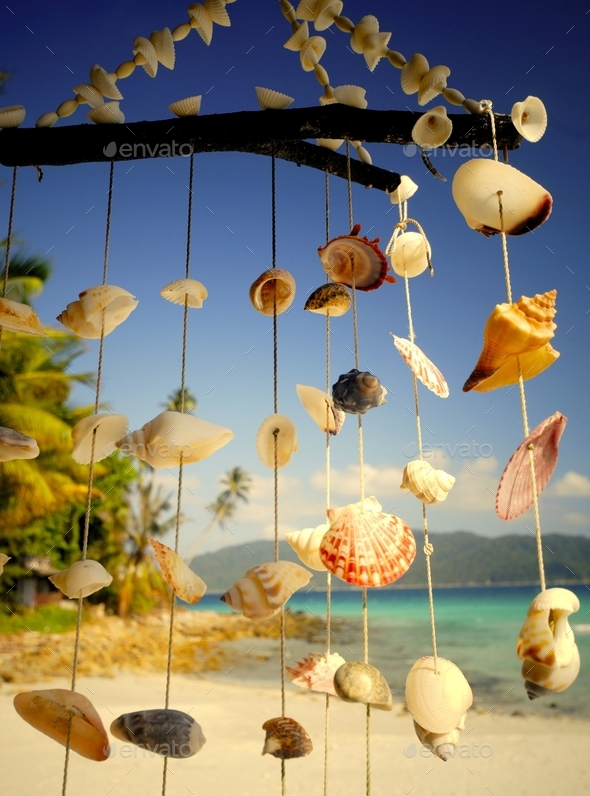 Sea shell chime at a tropical lagoon - Stock Photo - Images