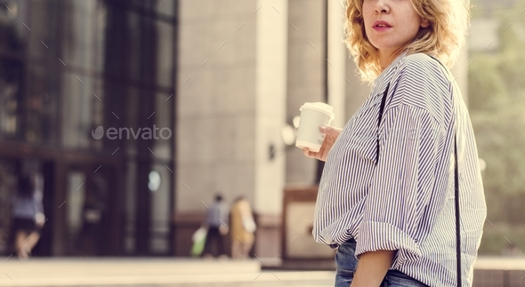 Closeup of woman with take away coffee - Stock Photo - Images