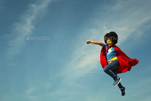 Girl with afro playing superhero - Stock Photo - Images