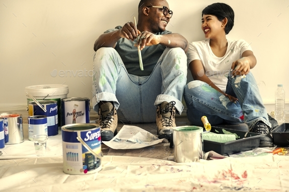 Couple painting house wall - Stock Photo - Images