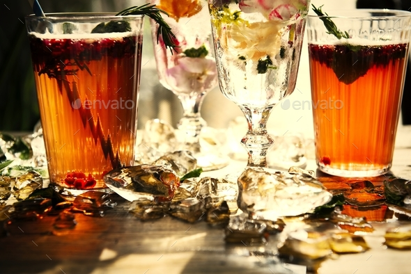 Summer cocktails with decorative flower petals - Stock Photo - Images
