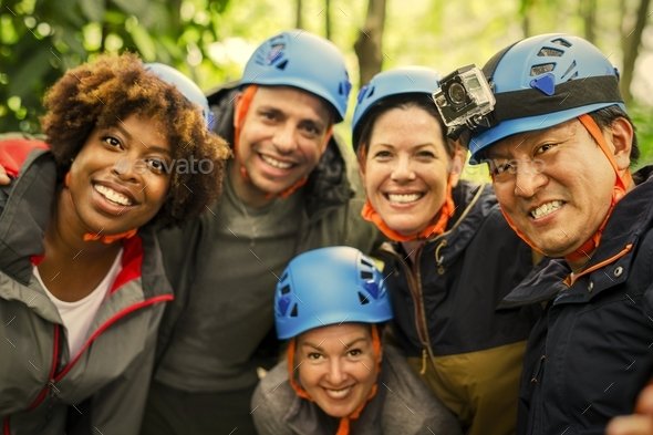 Group of diverse friends trekking together - Stock Photo - Images