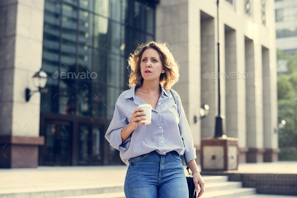 Business woman with a cup of coffee - Stock Photo - Images