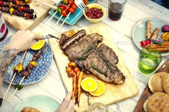 Closeup of homemade grill on wooden table at a summer party - Stock Photo - Images