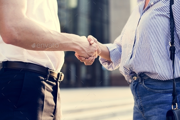 People greeting by shaking hands - Stock Photo - Images