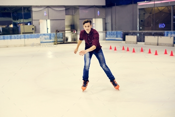 Man having fun with ice skating on the ice rink - Stock Photo - Images