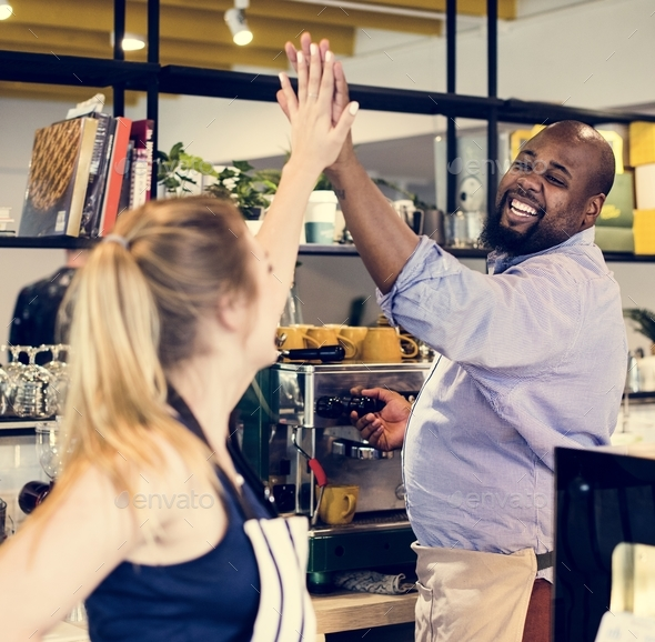 Colleagues give a high five to each other - Stock Photo - Images
