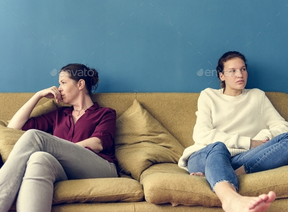 Mother and teenage daughter having an arguument - Stock Photo - Images