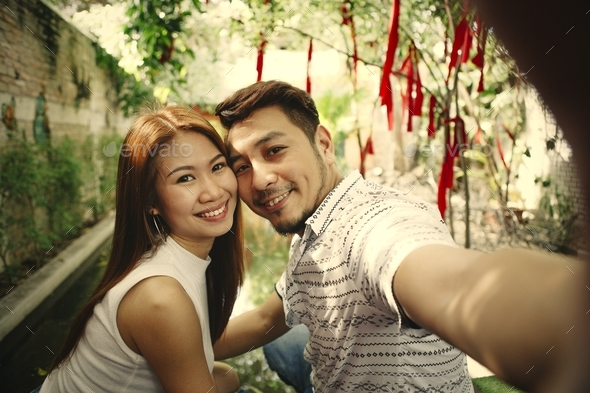 Happy couple taking selfie together - Stock Photo - Images