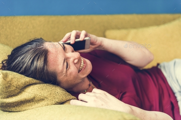 Caucasian woman talking on the phone - Stock Photo - Images
