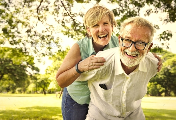 Cute senior couple in the park - Stock Photo - Images